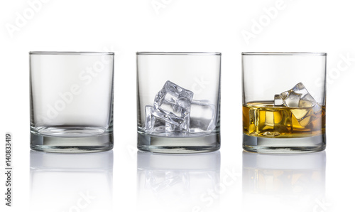 Photo sur Toile Alcool Empty glass, glass with ice cubes and glass with whiskey and ice cubes. Isolated on white background
