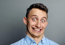 A Man Laughing Hysterically At Something Hilarious With A Funny Expression On His Face.