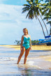 Girl model standing on the tropical beach