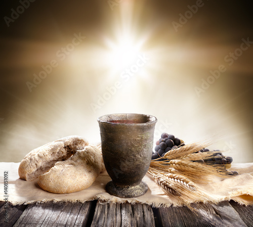 Communion - Unleavened Bread With Chalice Of Wine And Cross Light  Wall mural
