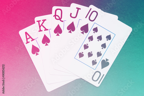Royal Flush playing cards hand on colorful background плакат