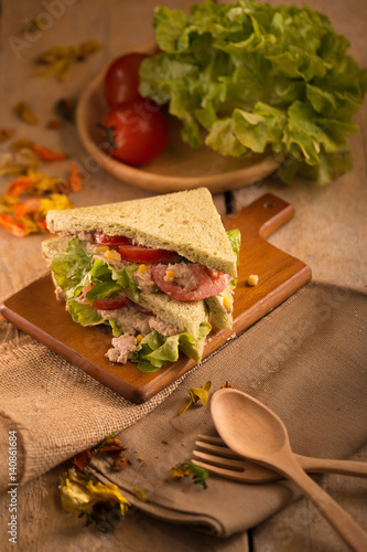 Staande foto Snack fresh made Tuna Sandwich on Wooden table in Golden Light. selective focus
