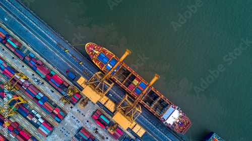 Valokuva  Container ship in import export and business logistic by crane