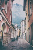 Narrow street on the background of mountains. Riva del Garda, Italy - 140870219