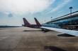 planes on runway in modern airport of China.