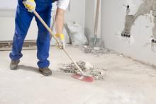 Construction Worker Sweeping Floor