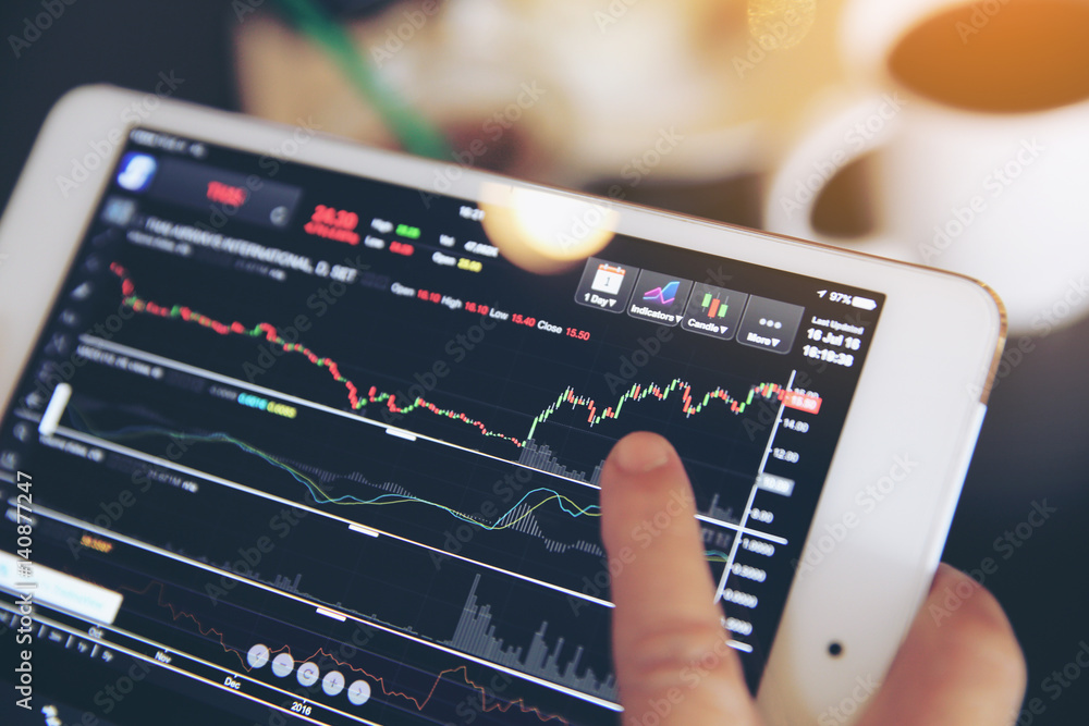Fototapeta trading online on tablet with business woman hand