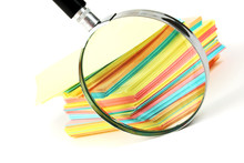 Magnifying Glass And A Stack O...