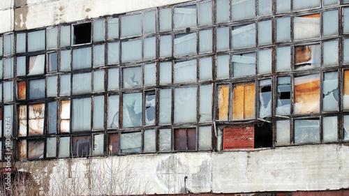Staande foto Industrial geb. Exterior with broken windows of an old industrial building