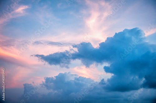 Bright colourful sunset sky with sunlight and clouds. Natural background and texture