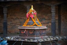 Black Tibetan Stupa With Buddha Eyes Decorated With Flowers In Kathmandu, Nepal