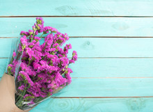 Statice Purple Flower On Wooden Floor, Place For Text.