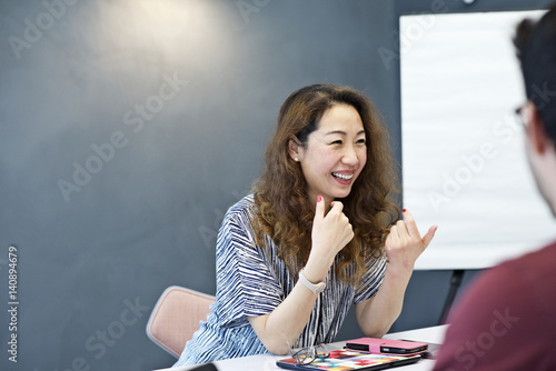 Senior chinese businesswoman in an office with colleagues