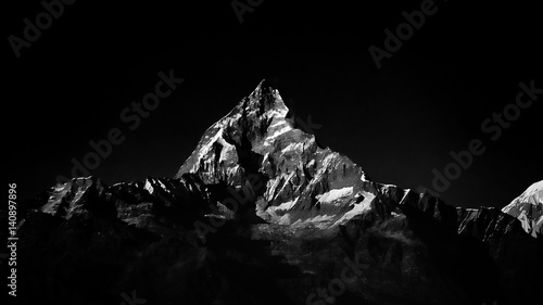 Machapuchare mountain peak in Himalaya. Black and white color.