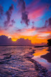 Bright colorful cloudy sky over the wild beach at sunset. Indian ocean shore, Sri Lanka.