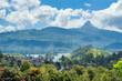 Maskeliya town and Adam`s peak on the horizon at sunny day