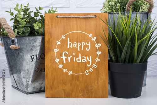 Fotografia  Wooden board with text happy friday