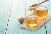 Honey With Wooden Honey Dipper...