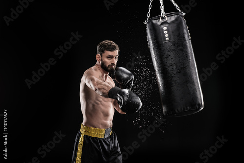 Photo  Boxer with punching bag