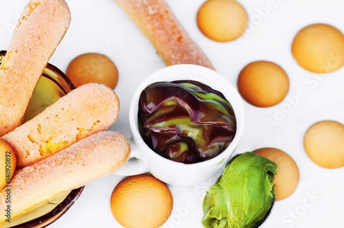 Fototapeta Long and rounded ladyfinger cookie,mousse chocolate and pistachio. obraz na płótnie