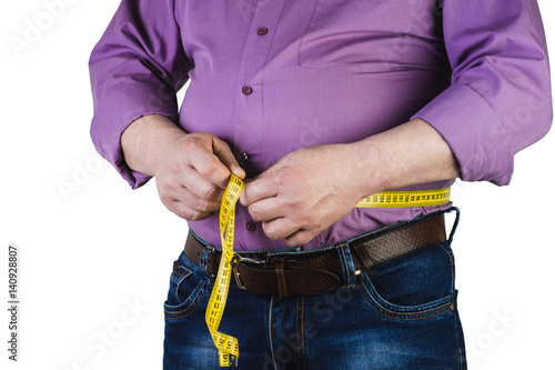 Photo Thick mature man measuring his belly with a measuring tape, isolated on white background