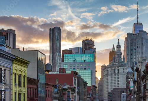 Sunset behind the buildings of Manhattan as seen from Chinatown, New York City NYC
