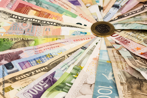 Fotografía  different mixed banknotes
