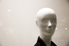 Bald Head Of Female Mannequin Behind Glass Is Large