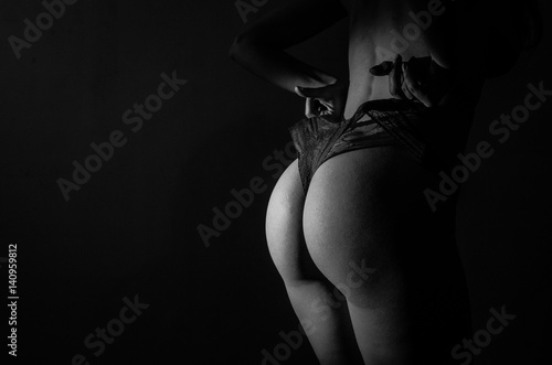 Naked woman body in lacy sexy panties on a dark background Poster