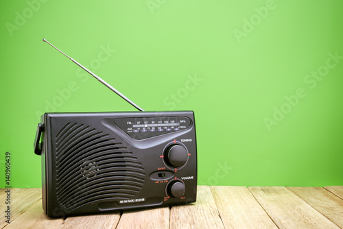 Retro AM FM Radio on wood board - Buy this stock photo and explore