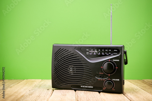 Retro AM FM Radio on wood board - Buy this stock photo and