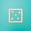 Wooden frame on a color background with seashells