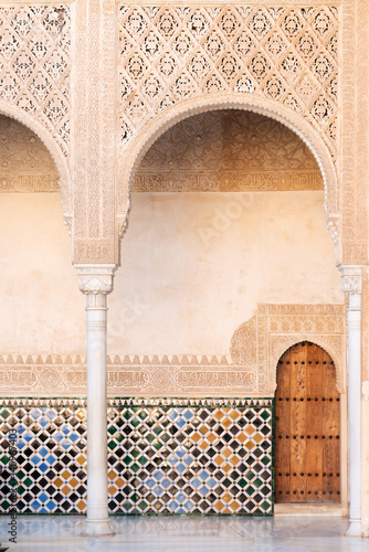 Moorish arches and columns of Alhambra harem in Granada, Spain Wallpaper Mural