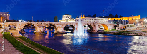 Panoramic view on Stone bridge from Oko bridge in Skopje in the evening