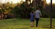 Man and woman hold hands and walk in slow motion