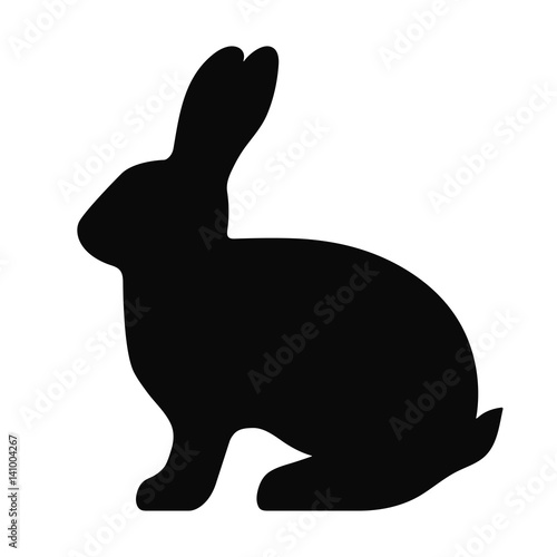 Leinwand Poster Black side silhouette of a rabbit isolated on white background