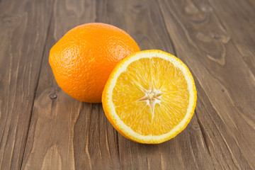 Fresh ripe orange on a wooden background