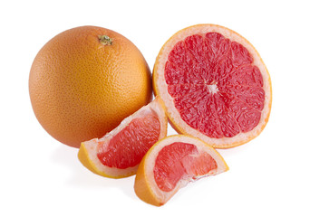 Pieces of pink grapefruit over white background