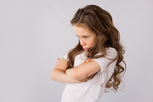 Portrait Of Angry And Sad Little Girl Isolated On White Background