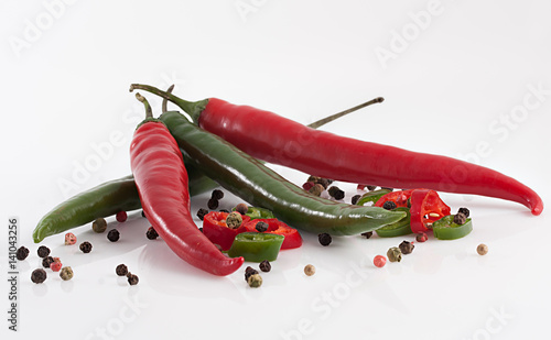 Staande foto Hot chili peppers Hot red chili or chilli pepper and black pepper balls on white background.