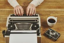 Woman Writing On A Typewriter.