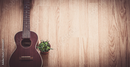 Fényképezés  Still Life Ukulele on Wooden Floor Background with Copy Space