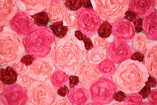 The Decoration Of Paper Flowers In Different Shades Of Pink.