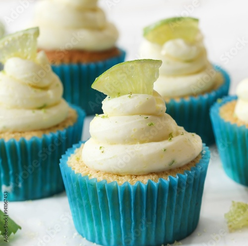 Homemade Key lime cupcakes with cream cheese lime zest frosting, selective focus Poster