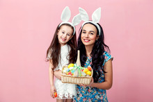 Easter, Family, Holiday And Child Concept - Close Up Portrait Of Little Girl And Mother Coloring Eggs For Easter
