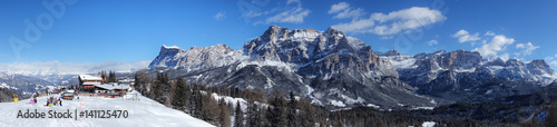 Corvara, Alta Badia winter panorama view with unrecognizable people near hut Wallpaper Mural