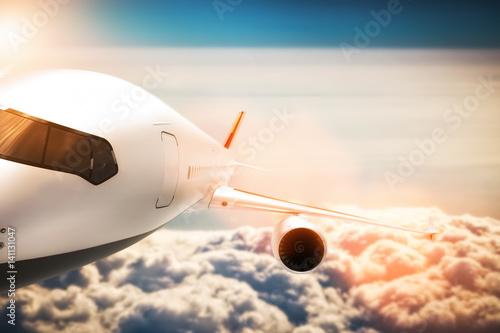 Fotografering  Passenger airplane flying at sunshine, blue sky.