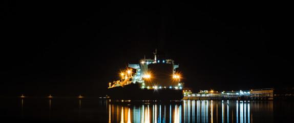 Fototapeta na wymiar LNG TANKER AT THE GAS TERMNAL - seaport at night