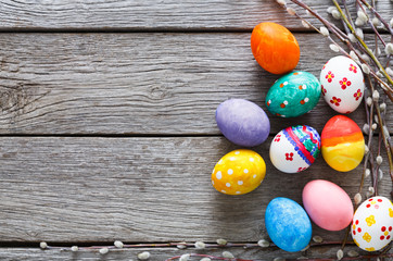 Colorful easter eggs on wood background