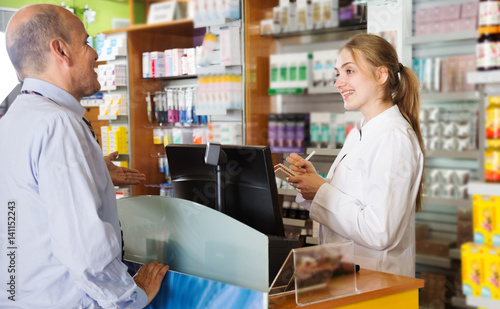 Staande foto Apotheek Person near counter in pharmacy